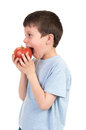Boy eat apple isolated on white Royalty Free Stock Photo