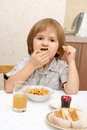 A boy eat cracker Stock Images