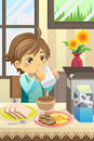 Boy eating breakfast Royalty Free Stock Photo