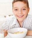 Boy eating breakfast Royalty Free Stock Image