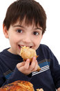 Boy Eating Chicken Royalty Free Stock Photo