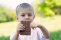 Boy is eating a chocolate bar Royalty Free Stock Photo