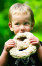 Boy eating a chocolate pretzel Royalty Free Stock Photo