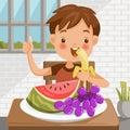 Boy eating fruit
