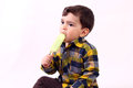 Boy eating icecream little an Stock Photography