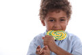 Boy eating a lolly pop littleoy Royalty Free Stock Photos