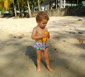 A boy eating a mango in the tropics Royalty Free Stock Photo