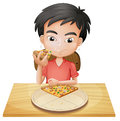 A boy eating pizza Royalty Free Stock Photography