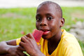 Boy eating popsicle Royalty Free Stock Photo