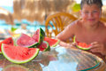 Boy eating sliced watermelon. Stock Photography