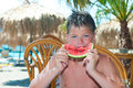 Boy eating sliced watermelon. Royalty Free Stock Images