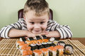 Boy eating sushi Royalty Free Stock Photo