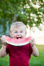 Boy eating watermelon Stock Image