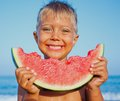 Boy eating watermelon handsome slice of on the beach Royalty Free Stock Images
