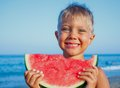 Boy eating watermelon handsome slice of on the beach Stock Photo