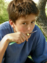 Boy eats apple with a knife Royalty Free Stock Photos