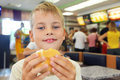 Boy eats hamburger Royalty Free Stock Images