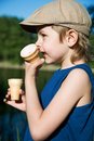 The boy eats ice-cream Stock Photo