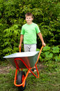 Boy with the empty wheelbarrow Royalty Free Stock Photography