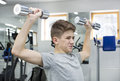 Boy engaged in the gym hall Royalty Free Stock Photo