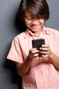 Boy enjoy playing a mobilephone portrait of cute Stock Photography