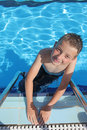 Boy enjoying a dip in the pool Royalty Free Stock Photo