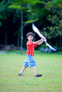 Boy enjoying his kite at the playground Royalty Free Stock Photography