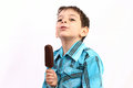 Boy enjoying icecream an isolate on white Stock Photo