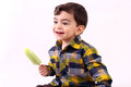 Boy enjoying icecream little an isolate on white Royalty Free Stock Photography