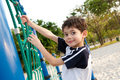 Boy enjoying the playground climbing activity. Royalty Free Stock Image