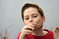 Boy enjoys pastry Royalty Free Stock Photo