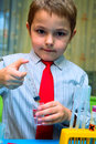 The boy enthusiastically studying chemistry Royalty Free Stock Photo