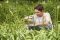 Boy examining plants with a magnifying glass young in forest Royalty Free Stock Photography