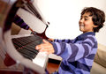 Boy excited about piano lessons Royalty Free Stock Photos