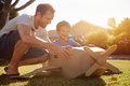 Boy father toy aeroplane son and dad playing with in the garden at home having fun together and smiling Royalty Free Stock Photos