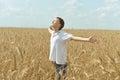 Boy In Field Enjoys Nature