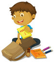 A boy filling schoolbag Royalty Free Stock Photo