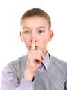 Boy with finger on his lips in silence gesture isolated the white background Royalty Free Stock Photography