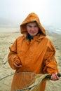 Boy with fisherman's coat Royalty Free Stock Photos