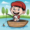 Boy fishing in a boat Royalty Free Stock Photo