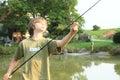 Boy fishing on pond Royalty Free Stock Photo
