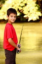 A boy with fishing rod Stock Photography