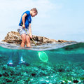 Boy fishing in the sea Royalty Free Stock Photo