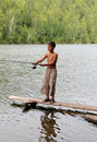 Boy fishing with spinning Royalty Free Stock Image