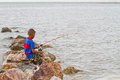 Boy fishing at thai sea thailand Royalty Free Stock Photo
