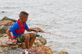 Boy fishing at thai sea thailand Stock Image