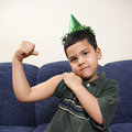 Boy flexing arm muscle. Stock Images