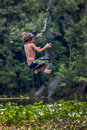 Boy flies backwards rope swing wacissa river a young as he releases from the at in the panhandle of florida Royalty Free Stock Photos
