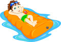 The boy floating on inflatable, summer vacation fun Royalty Free Stock Photo