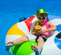 Boy floating in the swimming pool Stock Images
